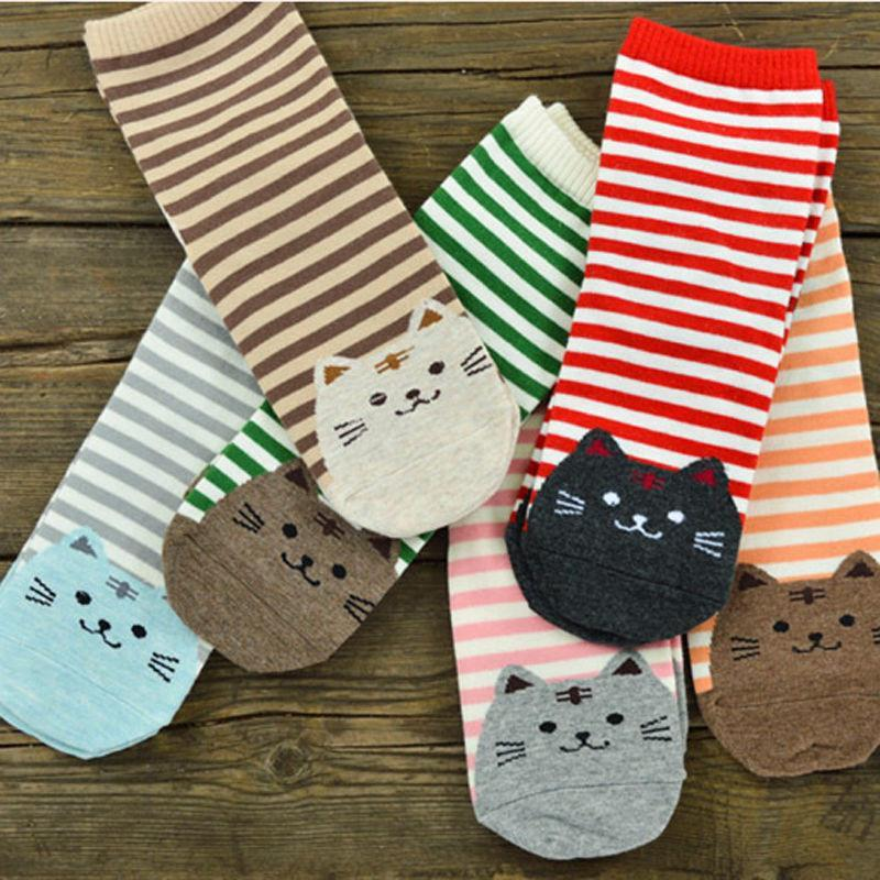 All Variations of Striped Socks laid out on table