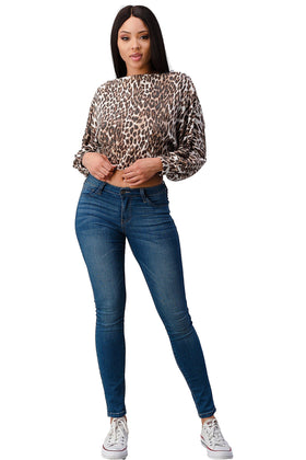 Cute and flirty long sleeve boat neck top, made in a leopard printed, brushed stretch knit fabric.