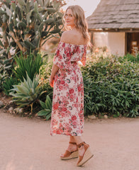 floral spring midi dress with smocked waist and statement sleeves