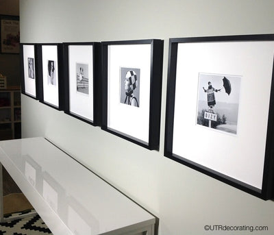 How to hang pictures in a row