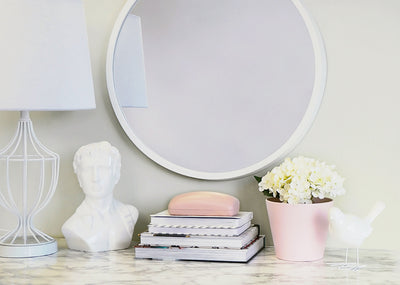 How to Hang a Mirror Without Ruining Your Walls