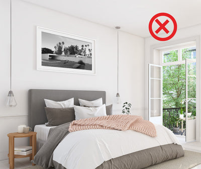 Most common picture hanging mistake in a bedroom