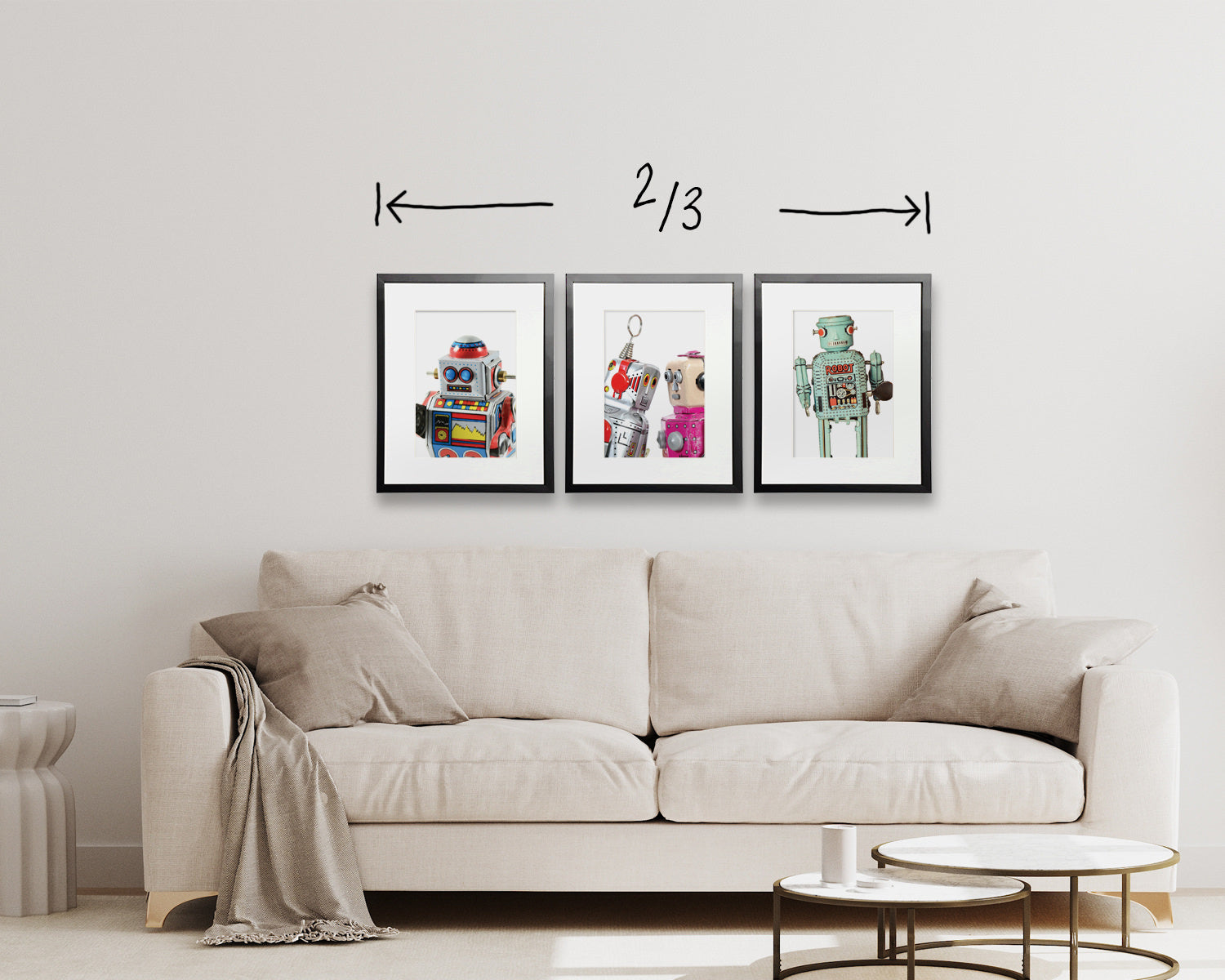 three frames hung above a sofa