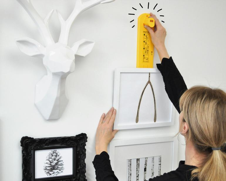 Using the Hang & Level picture hanging tool to hang a frame