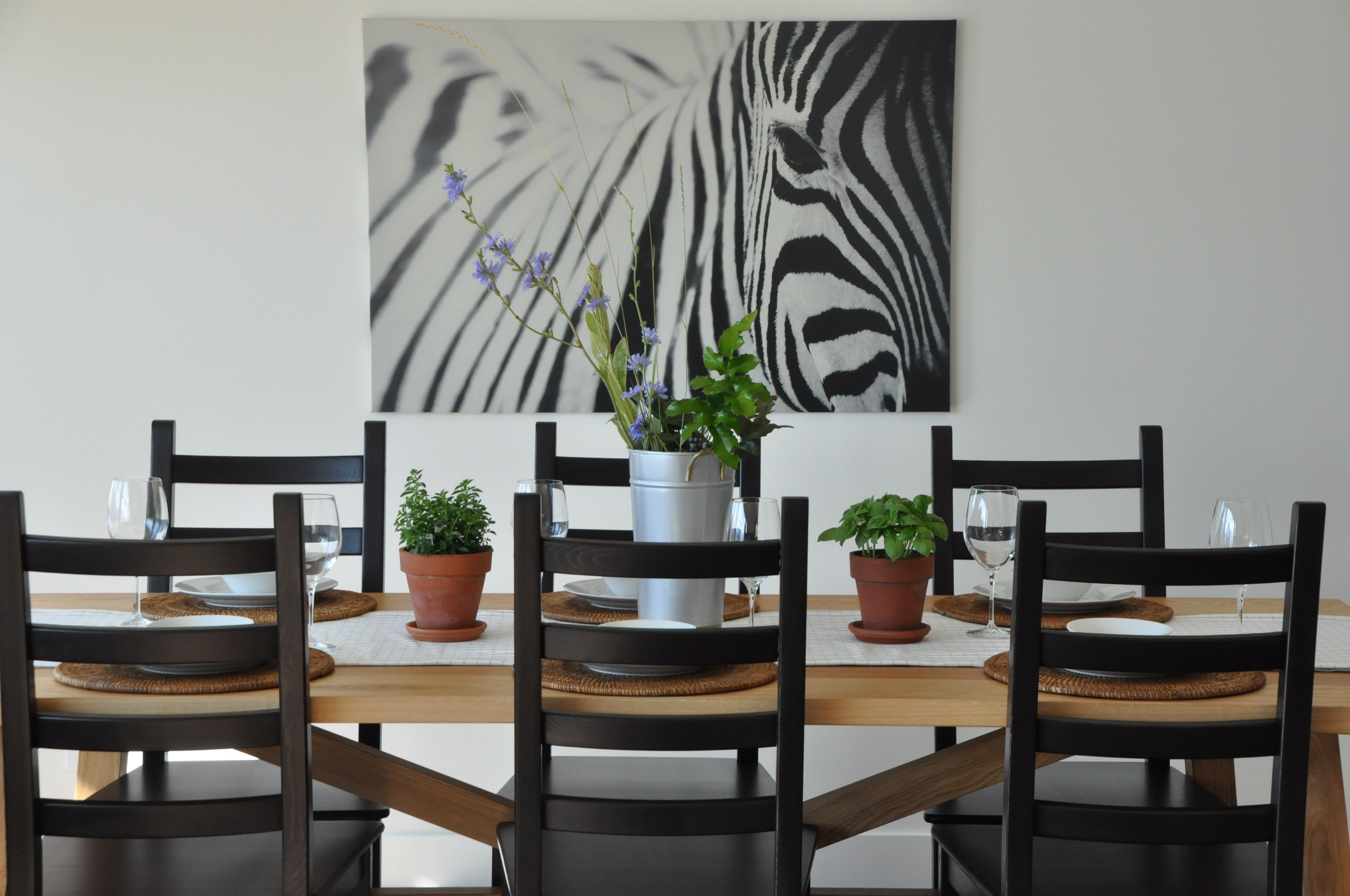 Zebra photo hanging above kitchen table