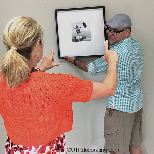 Couples hanging stuff together, hanging pictures with your partner