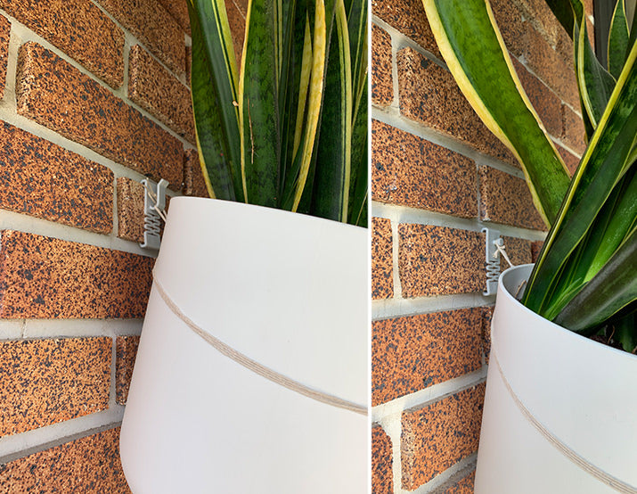 pots hanging on brick with DecoBrick