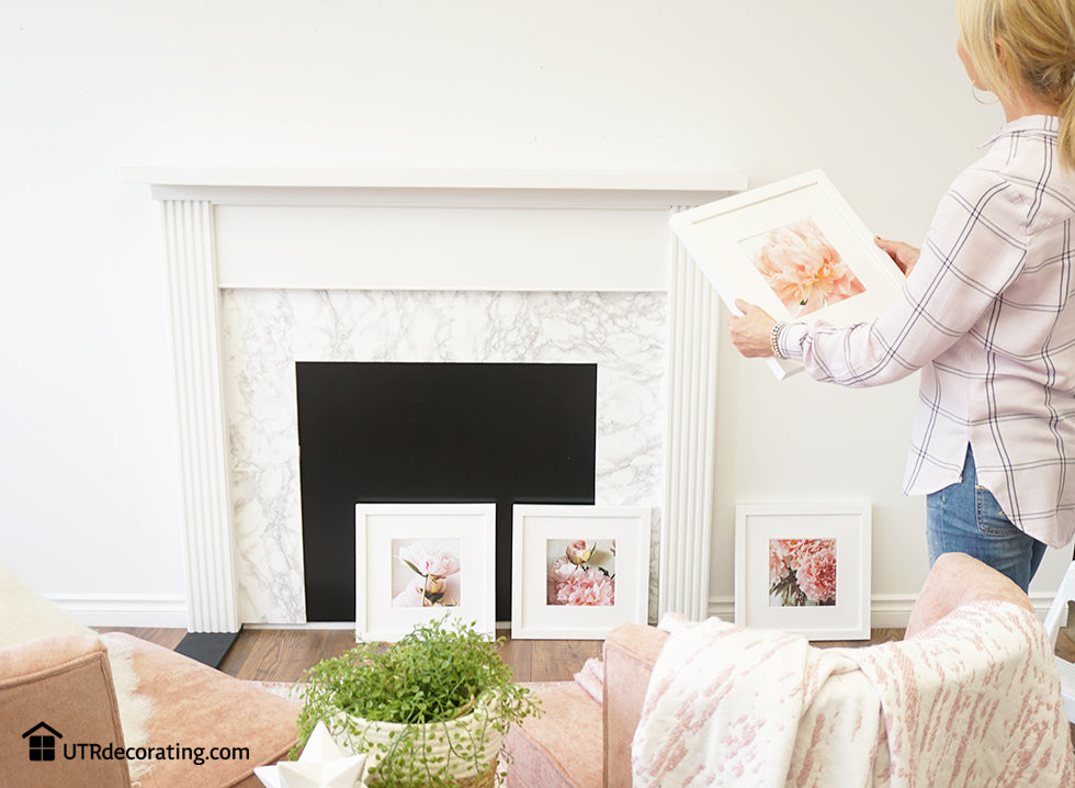 Creating a gallery wall above the mantel with Place&Push frames.