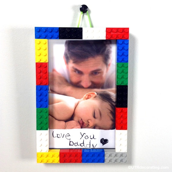 lego frame DIY hanging on the wall with photo of father and baby