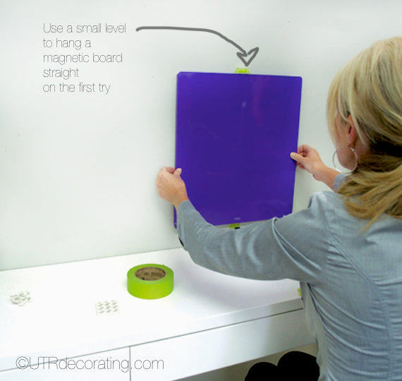 Using a small stick backing level to hang a magnetic board or similar other board will save you time and frustration