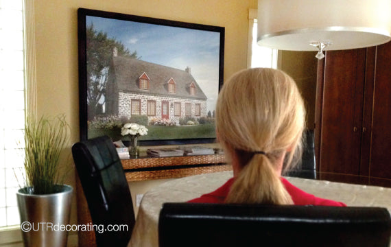 Hanging pictures in a dining room