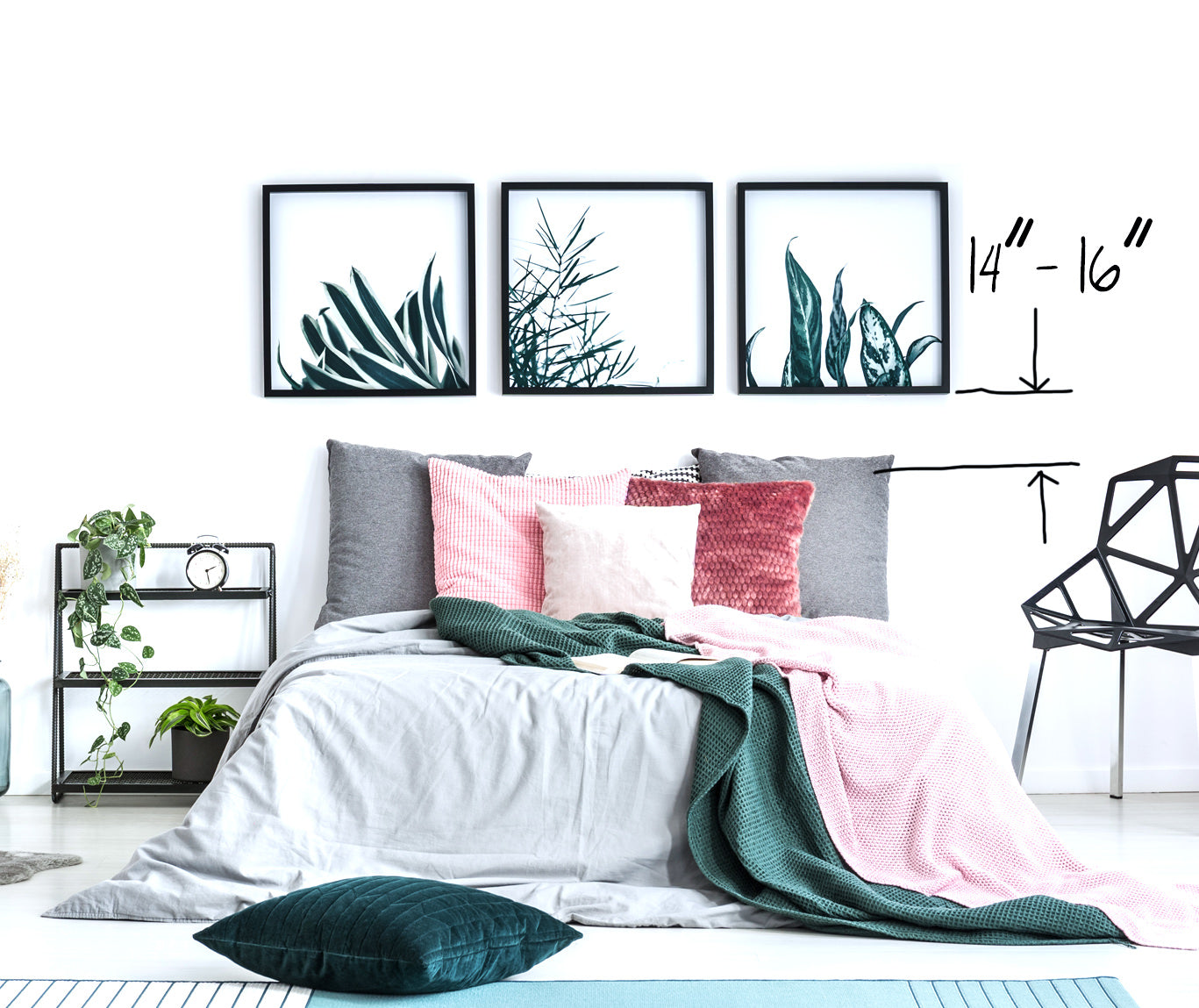 Hanging artwork above a bed with no headboard