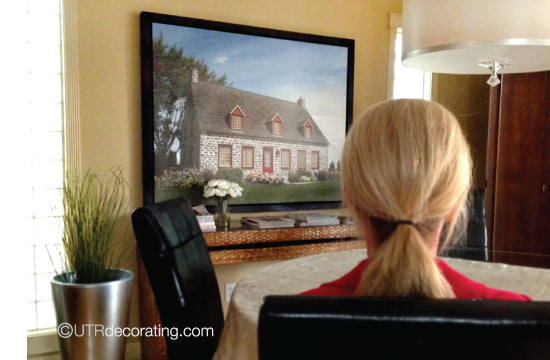 Hang your pictures lower in sitting rooms