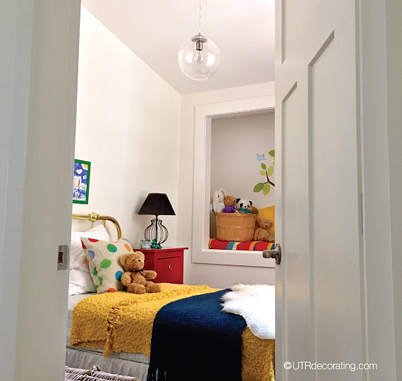 kids' bedroom after the makeover - colorful accessories are key when decorating a child's room