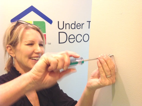 installing the first Déco Screw™ to hang a large mirror