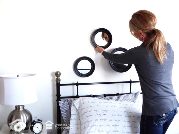 idea for over a bed: hang a mirror grouping