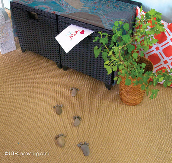 stone footprints leading to a Mother's Day surprise