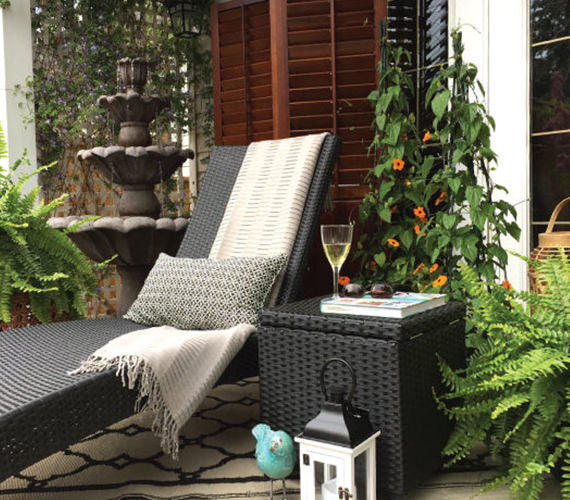 patio lounge chair and stand with fountain, greenery and outdoor décor