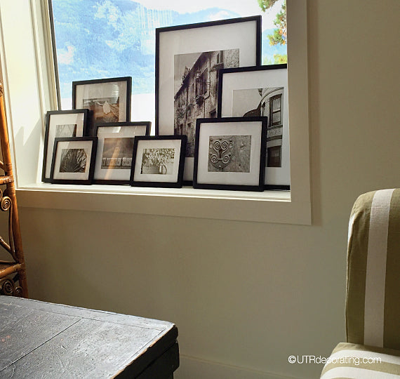 layered frames on a window sill