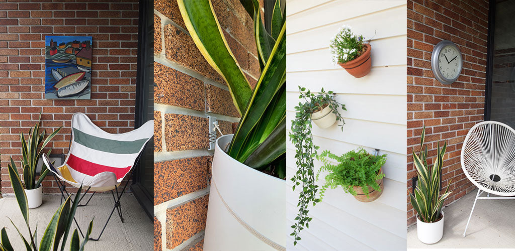 Items hung outdoors on brick and vinyl