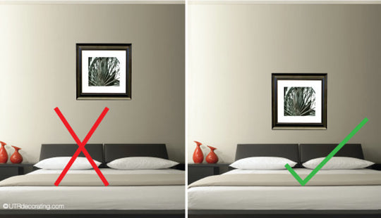 How high to hang pictures in a bedroom