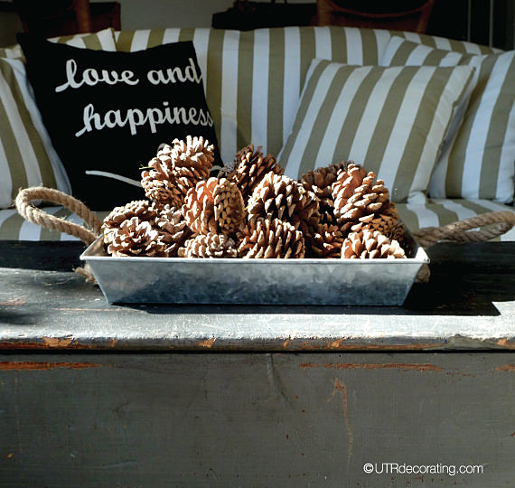 an example of fall decorating with pine cones