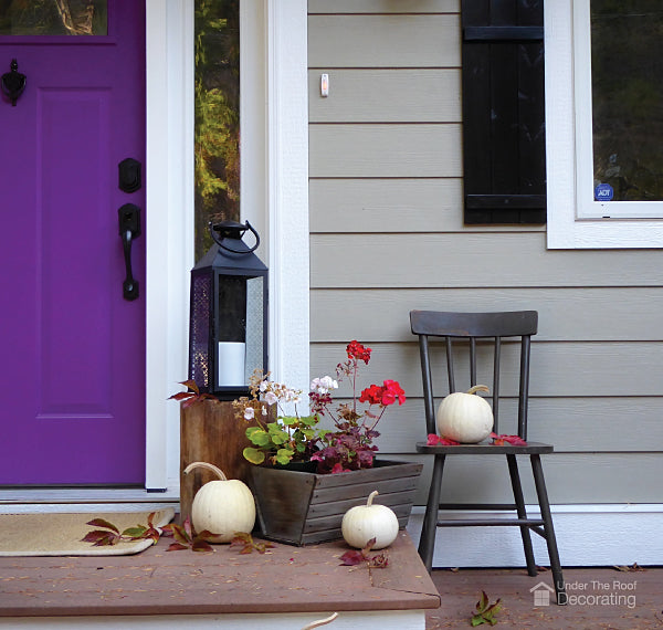 Pumpkins on a porch, one of our last minute Halloween decorating ideas
