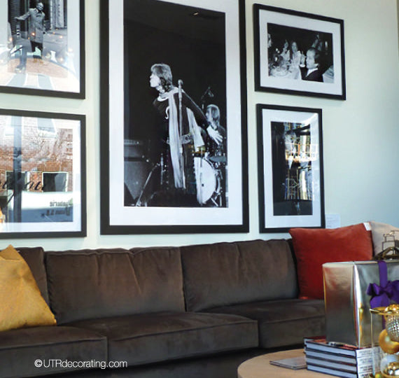 Black & white photographs above sectional sofa