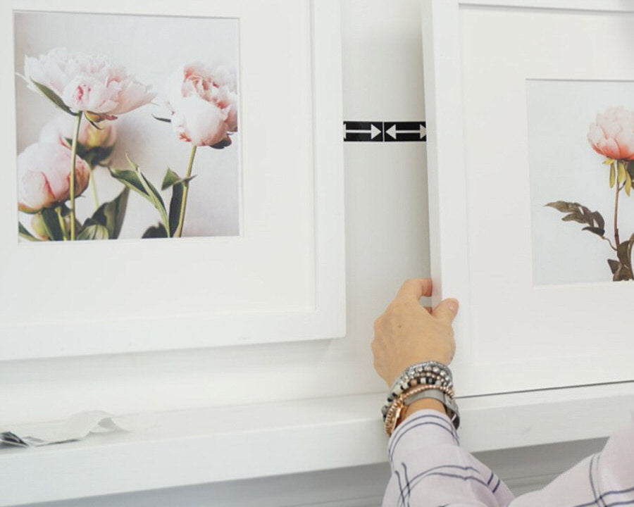 Using SpacingStrips to hang picture frames the correct spacing apart
