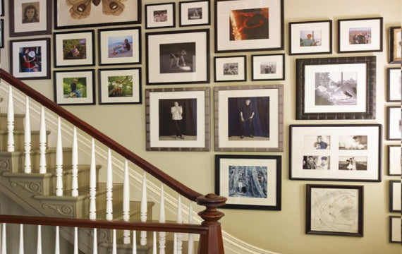 Hanging pictures in a staircase