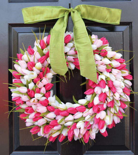 gorgeous wreath of pink and white tulips with green ribbon