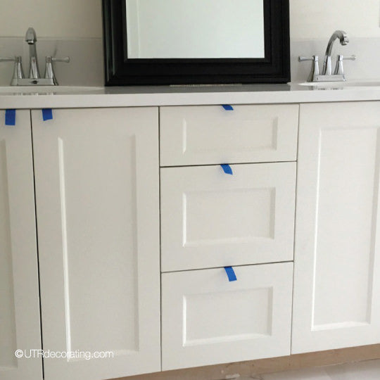 using painter's tape to stand in for cabinet hardware