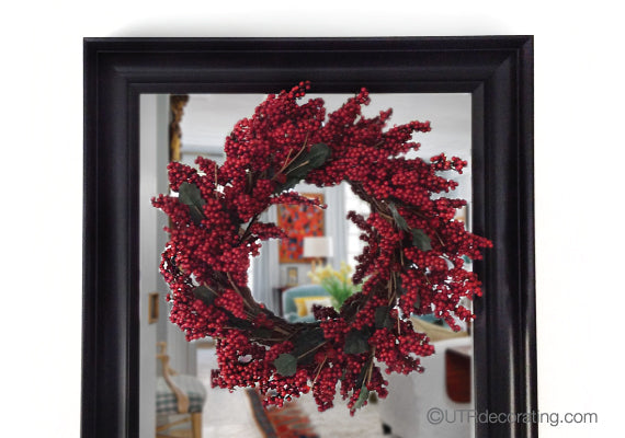 Add a bit of festive flair to your foyer with a colourful wreath