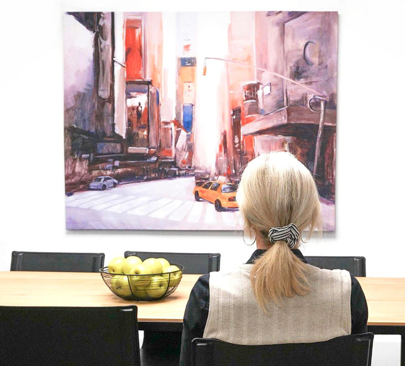 women sitting across from canvas in dining room
