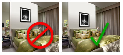 example of a picture hanging too high above a bed and a picture hanging perfectly above a bed