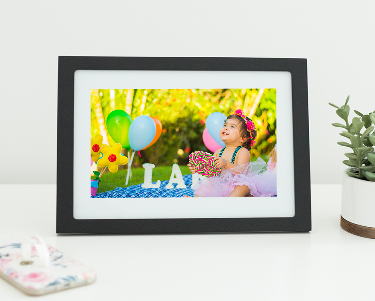 Celebrating a birthday party outside displayed in a Skylight Frame