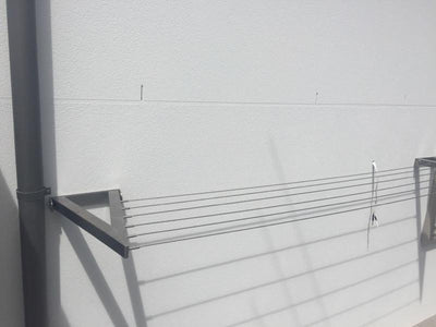 Evolution 316 Stainless Steel Clothesline - 4 Line Stainless Steel Actual Concrete Installed