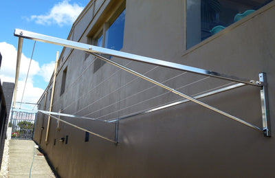 316 stainless steel clothesline mounted to brick wall