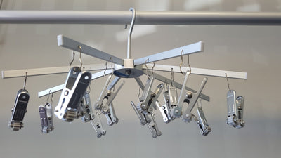 TopLine Umbrella Hanger installed on clothes line with 316 stainless steel pegs and open