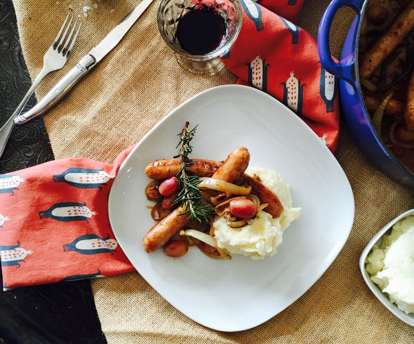 Provencal Pork Sausages with Rosemary, White Wine, Grapes & Truffle Mash