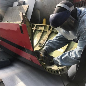 cutting up an airplane