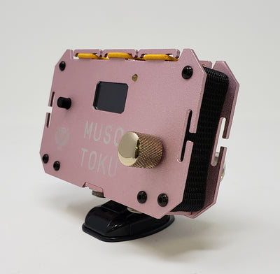 Your new Musotoku Pink Power Box comes with a convenient stand you can use for displaying on your work tray.