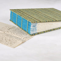 pinstipe-coptic album-opens flat-hand sewn-deckled pages-handmade-london