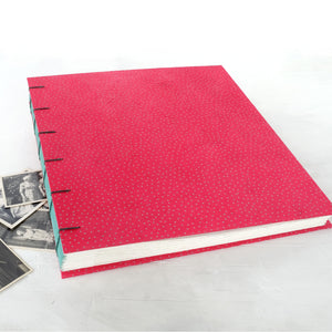 speckled pink-coptic album-hand sewn-cover-handmade books-the idle bindery