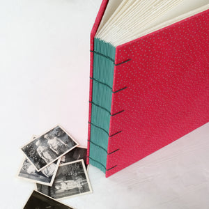 speckled pink-coptic album-hand sewn-deckled pages-handmade books-the idle bindery