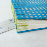 spot-coptic-album-deckled pages-exposed stitch-handmade-the idle bindery