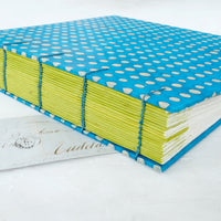 blue and lime spot-coptic-album-spine guards-exposed stitch-handmade-the idle bindery