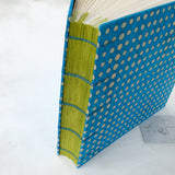 spot-coptic-album-stitch detail-exposed stitch-handmade-the idle bindery
