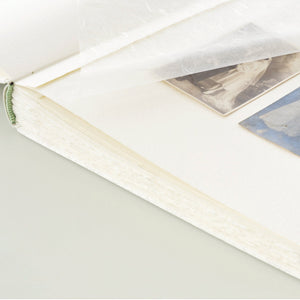 white silk-elegant wedding album-traditional-interior-handmade-london