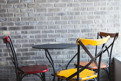 Interior Design Bloggers 2019 - Coloured Cross Back Cafe Chairs around Table
